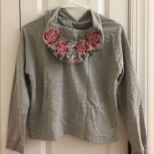 Grey cropped hoodie with flower decals on hood